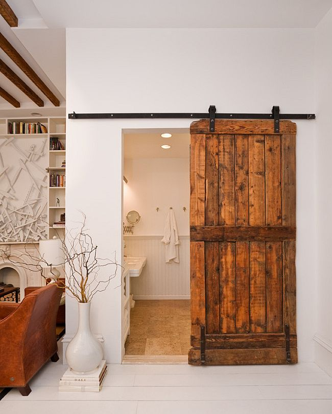 Modern eclectic bathroom with a lovely barn door