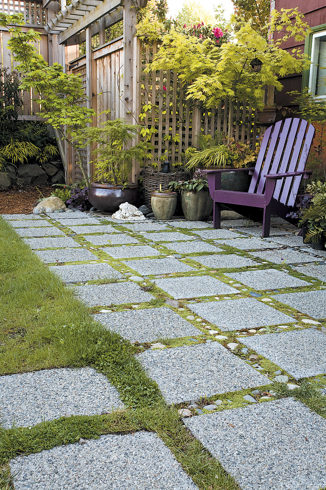 Small back yard with permeable patio of stone paves designed for groundwater retention; Jennifer Carlson garden