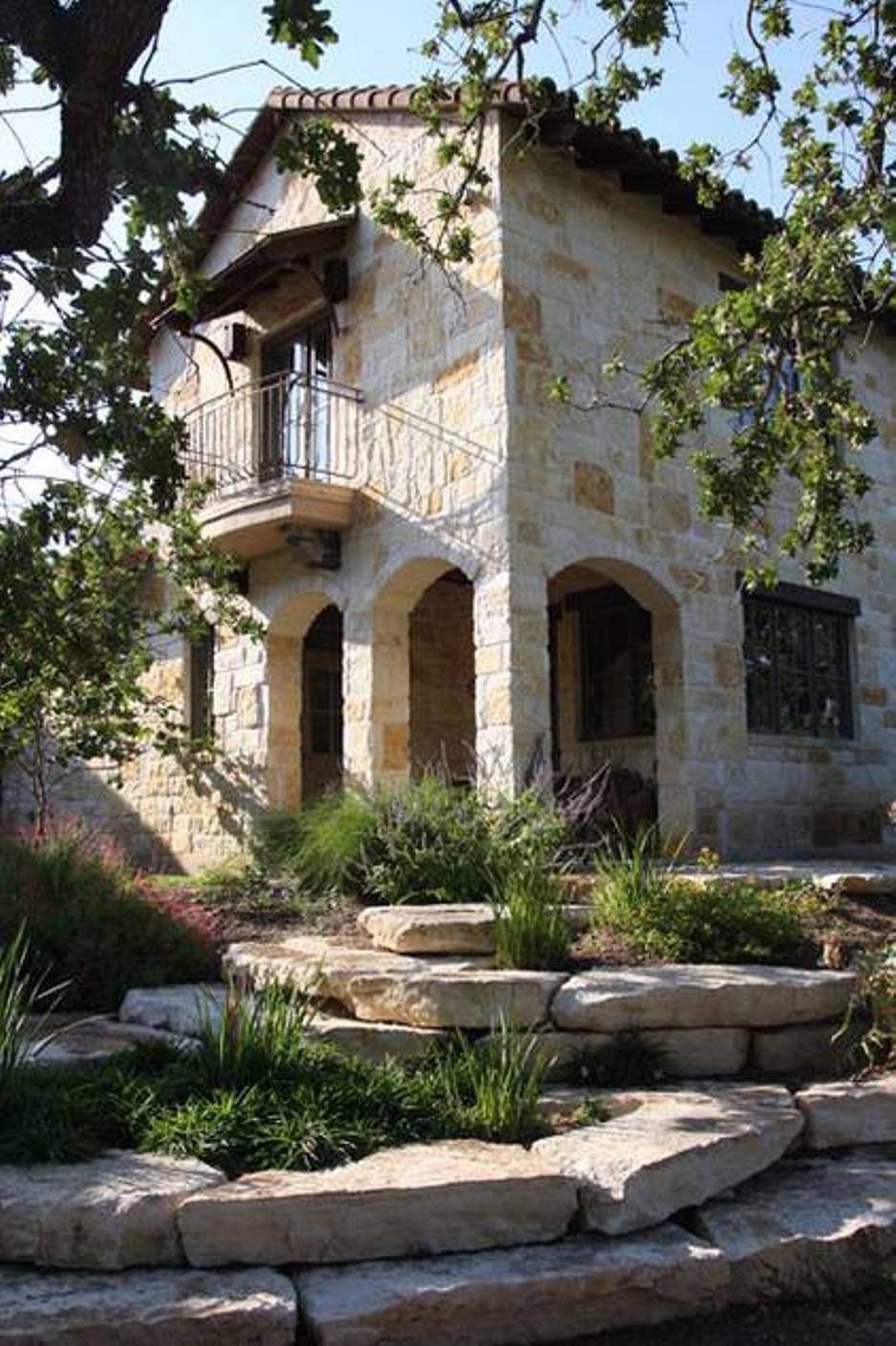 Mediterranean House Exterior Design with Stone