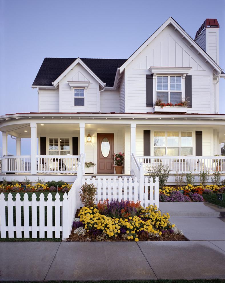 White Picket Fence Wrap around Porch House Traditional Exterior Design