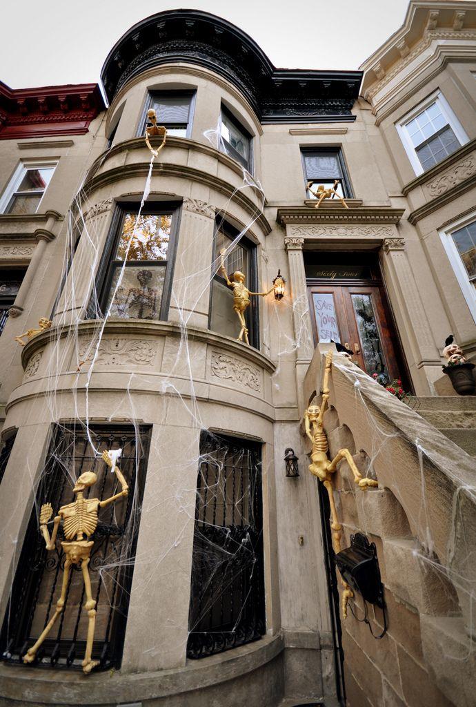 Halloween Skeletons Climbing On House