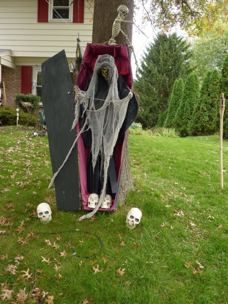 Scary witch dolls on garden featuring inspiring halloween outdoor decoration idea