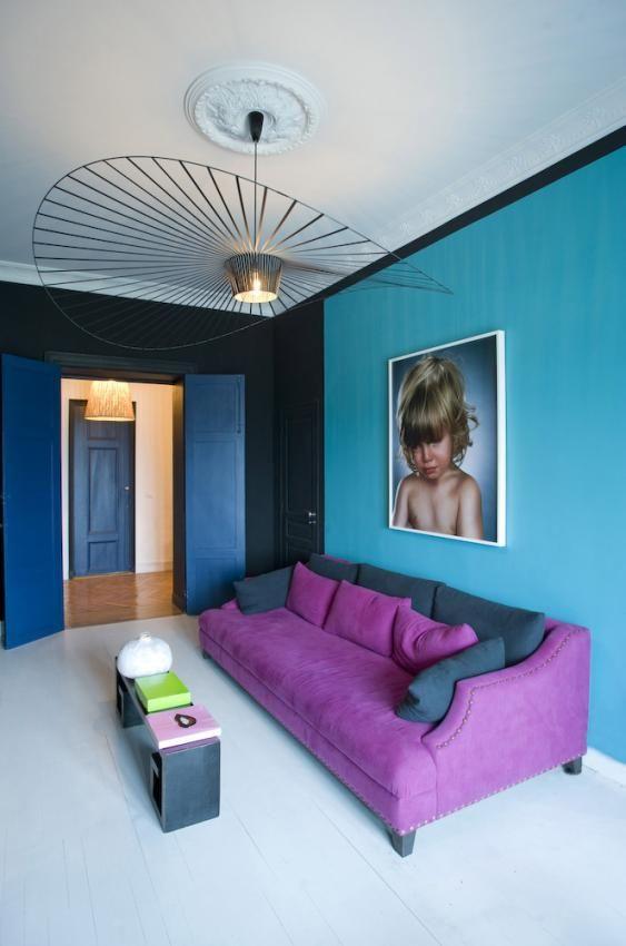 purple-sofa-and-blue-wall