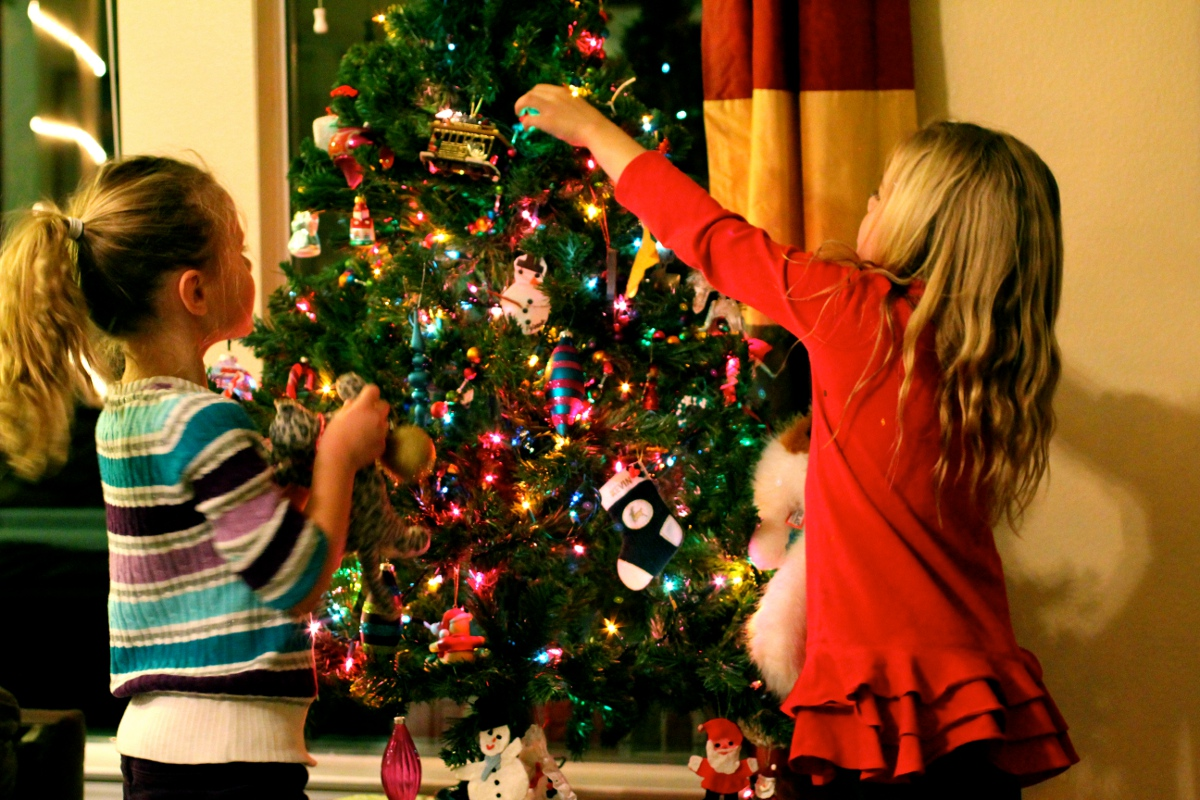 children-decorating-christmas-tree-fine-design