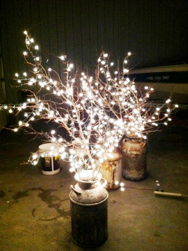branches-with-lights-in-a-milk-can